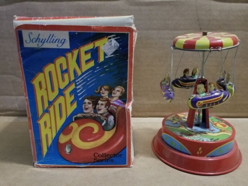 SCHYLLING ROCKET RIDE SPINNING CAROUSEL COLLECTOR SERIES WIND UP TIN TOY