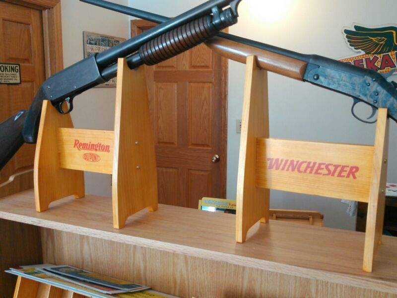 Remington or Winchester shotgun or rifle holder that sets on the counter.