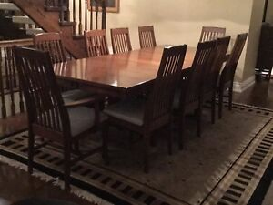 Wood dining room table with ten chairs