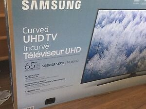 "Samsung 65"" curved UHD tv. BRAND NEW NEVER USED"