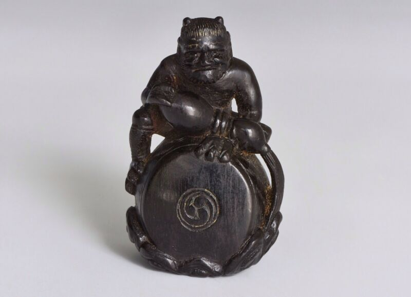 A Meiji Era Japanese Wooden Carved Netsuke Of Raiden