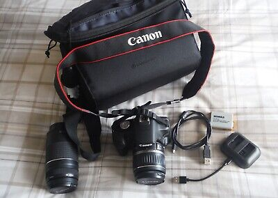 Canon EOS 500D DSLR with two lenses.