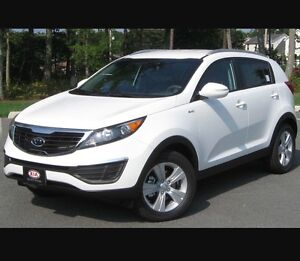 Selling my white 2015 kia sportage $238 bi-weekly for 47 months