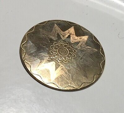 Antique brass button featuring dragon has brass loop shank and measures 1.18 dia