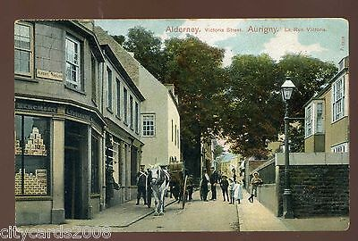 CHANNEL ISLANDS  ALDERNEY  Victoria Street with Shop and Delivery cart  coloured