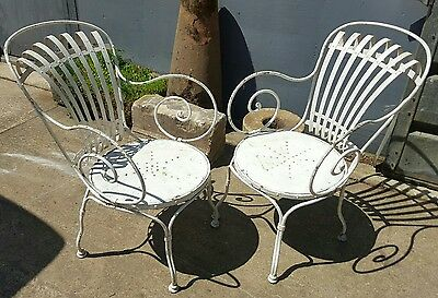 Rare pair of large Francois Carre armchairs
