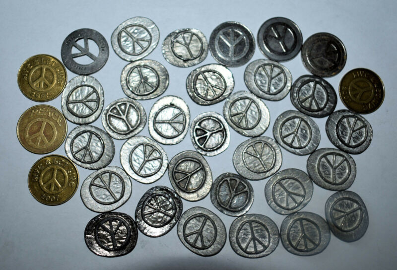 12. LOT OF 35 PEACE SYMBOLS CAST IN PEWTER-LIKE METAL, SOME COINS FOR PEACE
