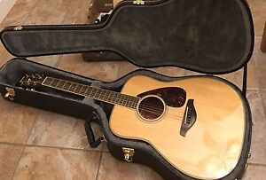 Solid top Yamaha acoustic guitar