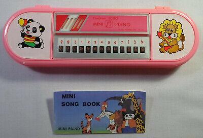 ELECTRON ECHO VTG 80's MINI PIANO + SONG BOOK IN PINK PENCIL