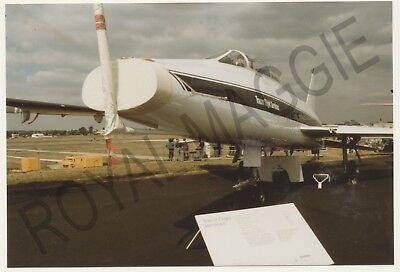 Colour print of North American TF 100F Super Sabre N416FS at Farnborough in 1990