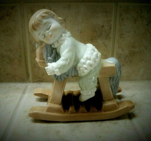 KALIQUE PORCELAIN ROCK-A-BYE LITTLE COWGIRL WHO FELL ASLEEP RIDING HER HORSE