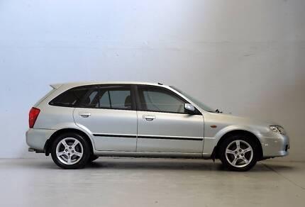 2003 Mazda 323 Hatchback AUTO SHADES