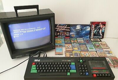 Amstrad CPC464 with Colour Monitor. Fully working & refurbished. 26 FREE Games!