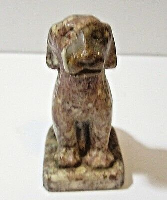BROWN WHITE CARVED SOAP STONE OR SIMILAR SITTING DOG FIGURINE