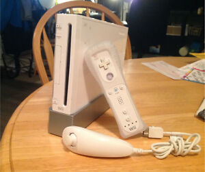 Wii w/ 4 remotes and nunchucks