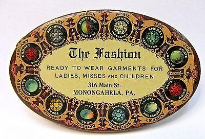 circa 1910 THE FASHION Ladies Garments MONONGAHELA PA celluloid pocket mirror *