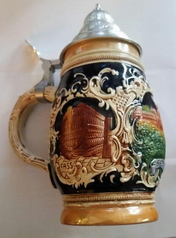 Vintage heidelberg beer stein with pewter lid.