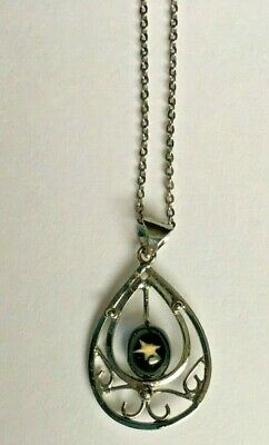 Oval Silver Pendant necklace with Gold Star encased in Acrylic Circle