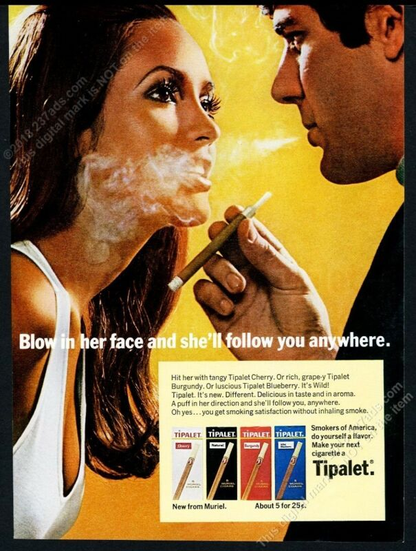 1969 Tipalet cigar man blowing smoke in woman
