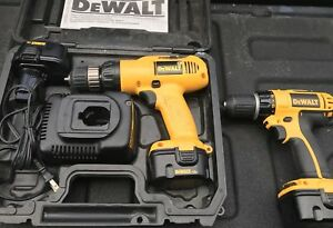 Pair of 12 volt DeWalt Drills Three batteries Charger and a Case