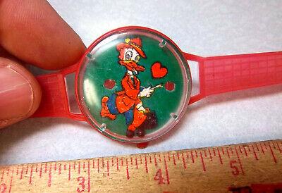 Vintage 1960s Walt Disney Donald Duck plastic toy puzzle watch, Hong Kong, NEW