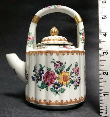 Vintage blue enamel teapot kettle with colonial couple design