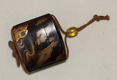 antique Japanese carved lacquer Inro showing a wild river, Edo, 19th century.