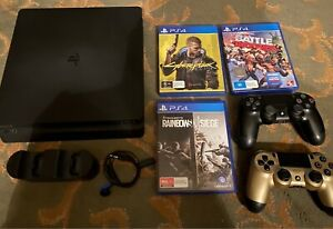 Sony PlayStation 4 PS4 1TB with controllers and games