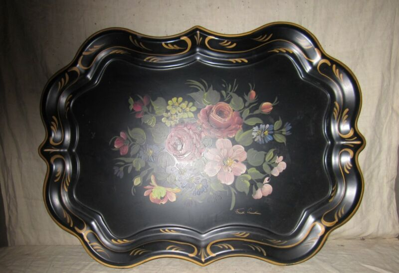 A LARGE HAND PAINTED SERVING TRAY