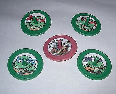15 TEENAGE MUTANT NINJA TURTLE SPIN SPINNING TOPS MIXCOLOR BIRTHDAY PARTY FAVORS](Ninja Turtle Birthday Favors)