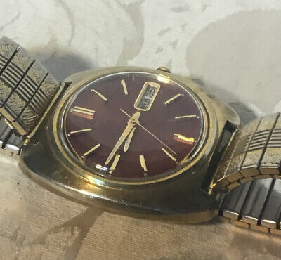 Beautiful Vintage Gold Seiko 7006 automatic with Dark Red Dial. Runs Excellent.