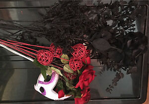 Black and red silk flowers