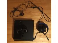 Playstation 4 with 10 games and headset
