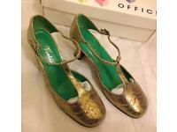 Gold T bar shoes