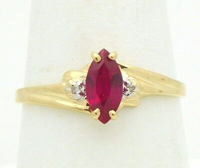 (CREATED RUBY SOLITAIRE RING SOLID 10 K GOLD 1.3 g SIZE 8.25)