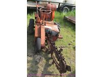 Vintage wall behind ditch witch trencher