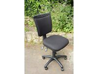Adjustable height and swivel office chair in excellent condition.