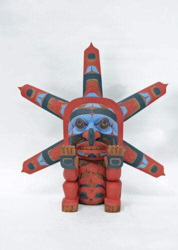 "Seated Sun Figure by Don Lelooska  Kwakiutl -- Late 20th century 21"" x 20"""