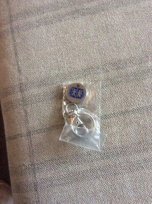 BRAND NEW IN PACKET CHARITY  £1 TROLLEY TOKEN & LOBSTER CLASP