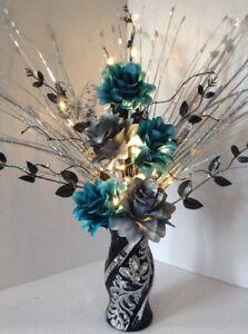 Artificial Silk Flower Arrangement Silver & Teal In Glitter Black Vase Lights Up