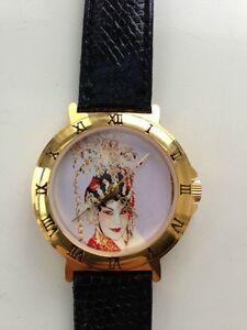 Chinese opera watch - wind-up mechanical gold plated watch.