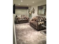 Sofology 2 x two seater sofas 2 Piece Suite Black Gold Stripe 12 Months Old Immaculate Condition