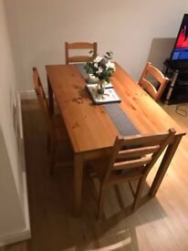 Classically simple table and chairs in excellent condition - fit in very well in any decor!