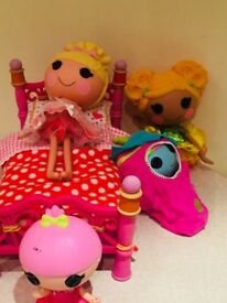 Group of la la loopsie toys with bed