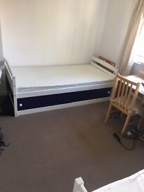 Two white & blue singles wooden beds with memory foam mattresses
