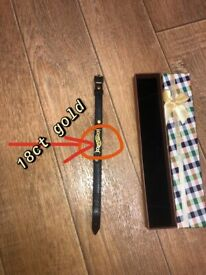 18ct gold with real leather wrist band