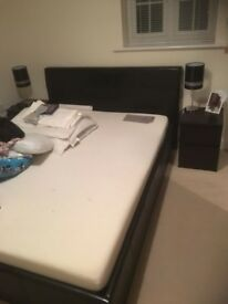 Black faux leather double bed, silent night mattress and 2 dark bedside units