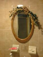 Oval Mirror with dry flower arrangement  $25.