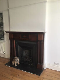 Fireplace wood surround and cast iron surround, slate hearth, gas fire