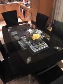 Glass dining table & 6 black leather chairs